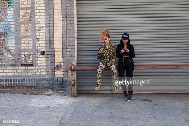 Portrait of two stylish young women