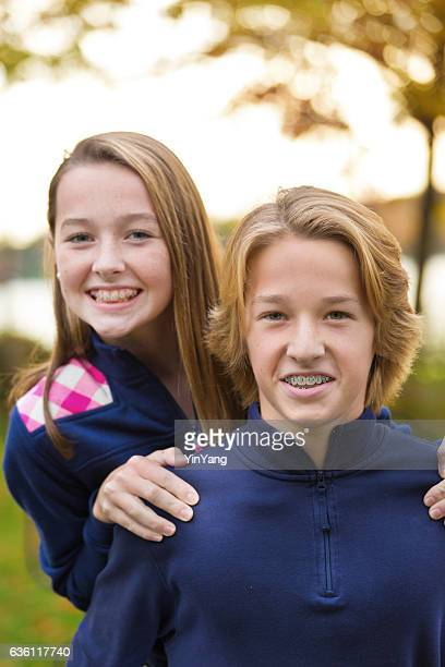 portrait of two teenagers with orthodontic braces - brace stock pictures, royalty-free photos & images