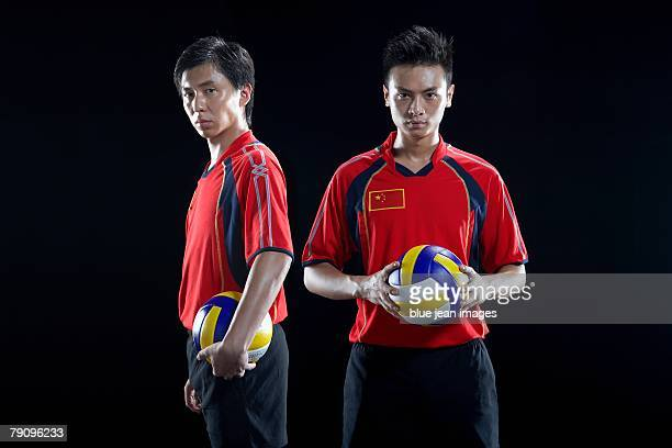 portrait of two volleyball players. - スポーツユニフォーム ストックフォトと画像