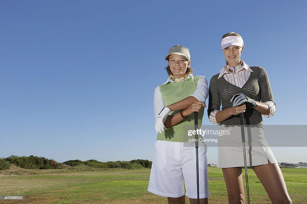 Portrait of Two Women in Golf wear : Stock Photo