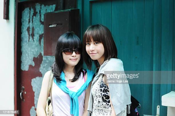 Portrait of two women on Jin Xian Lu