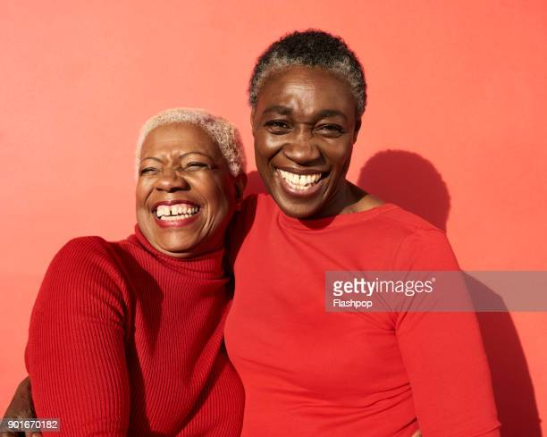 portrait of two women smiling - top garment stock photos and pictures