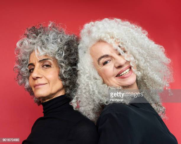 portrait of two women smiling - curly stock pictures, royalty-free photos & images