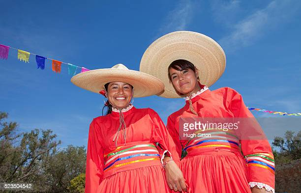 portrait of two women wearing traditional mexican clothing - hugh sitton stock pictures, royalty-free photos & images