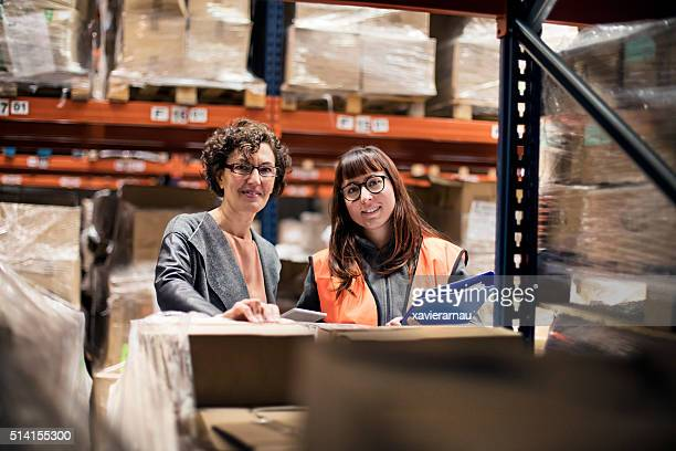 Portrait of two women working at a warehouse