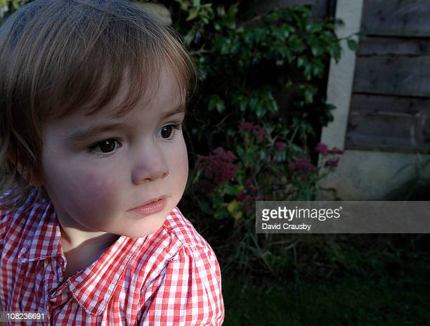 portrait of two year old girl thinking - crausby stock pictures, royalty-free photos & images