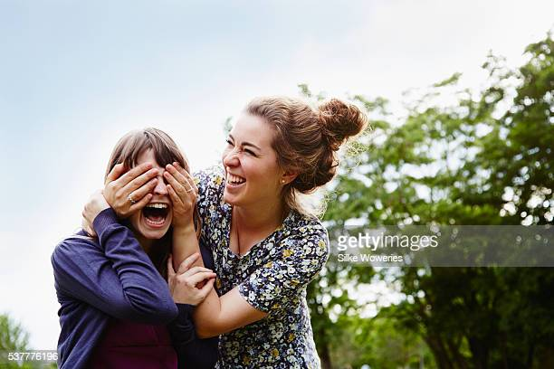 portrait of two young adult women having fun outdoors in the park
