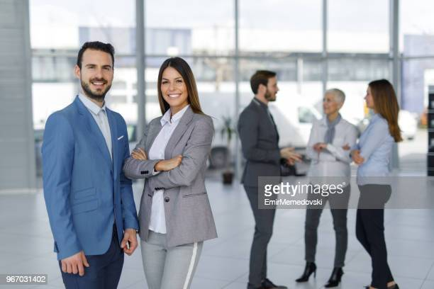 Portrait of two young business people at work