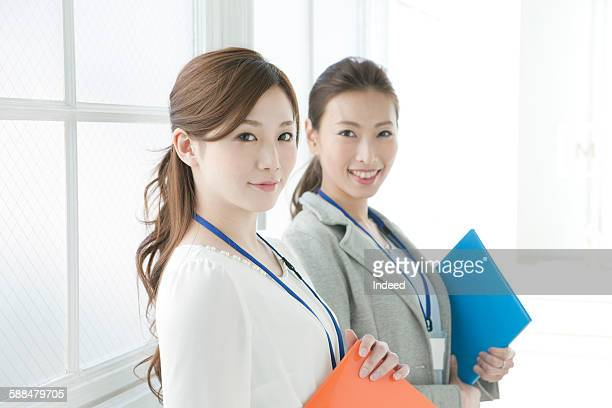 Portrait of two young businesswomen
