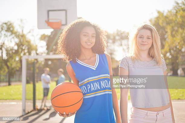 Portrait of two young female basketball players