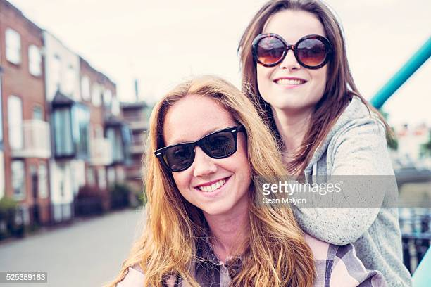 portrait of two young female best friends in sunglasses - sean malyon stock pictures, royalty-free photos & images