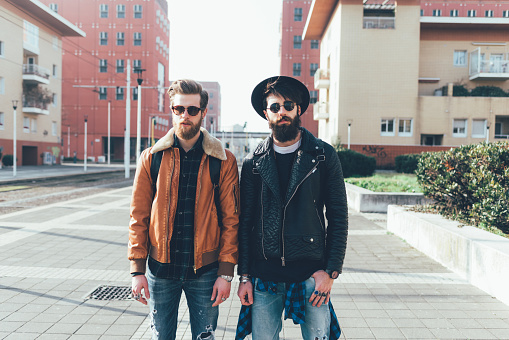 Portrait of two young male hipster friends standing in city housing estate - gettyimageskorea