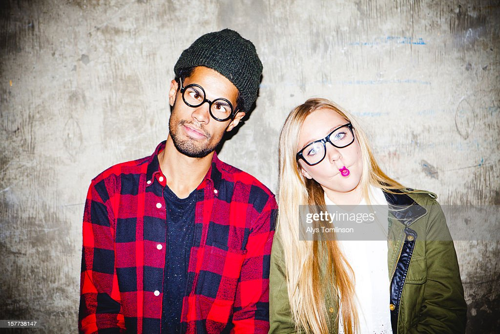 Portrait of two young people pulling funny faces : Foto de stock