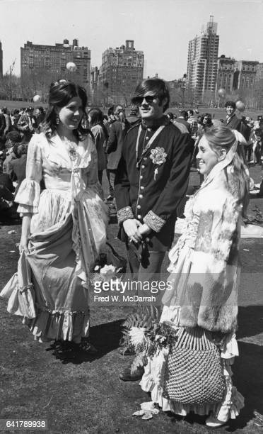 Portrait of two young women and a man all in costume as they attand the 'Easter BeIn' on Central Park's Sheep Meadow New York New York March 26 1967