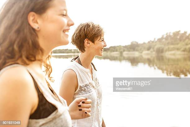 Portrait of two young women having fun at quarry pond