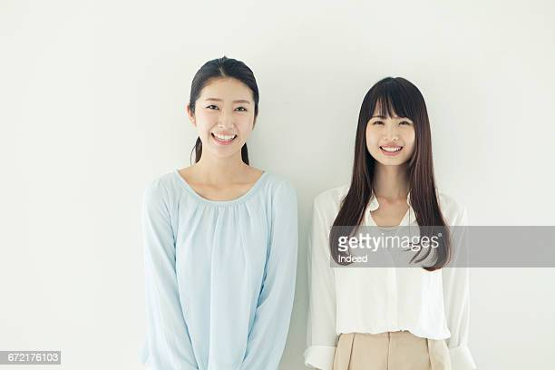portrait of two young women - 上半身 ストックフォトと画像
