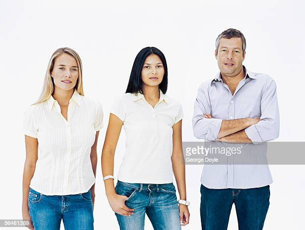 portrait of two young women standing with a mid adult man - side by side stock photos and pictures