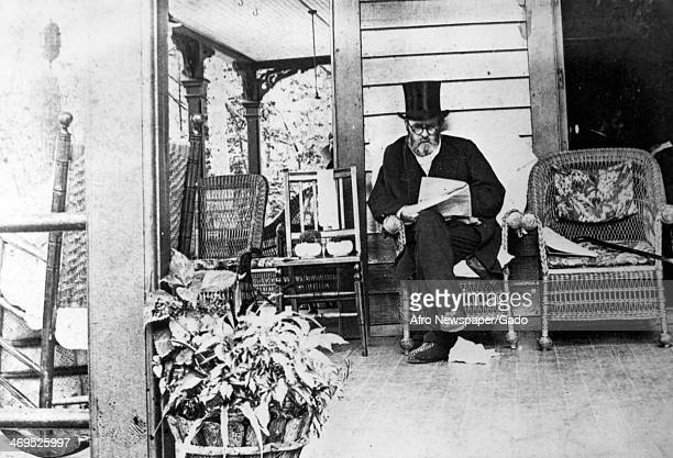 Portrait of Ulysses S Grant, General in the Union army in the American Civil War and then President of the USA, on a house porch reading. Thought to...
