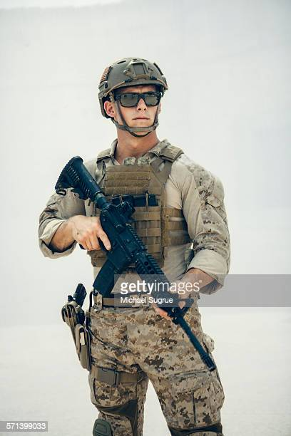Portrait of United States Marine on patrol.`