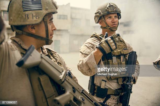 portrait of united states marines on patrol. - santa clarita stock pictures, royalty-free photos & images