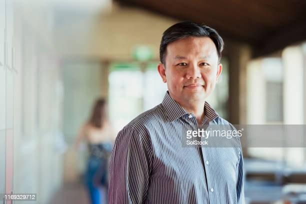 portrait of university professor - teacher stock pictures, royalty-free photos & images