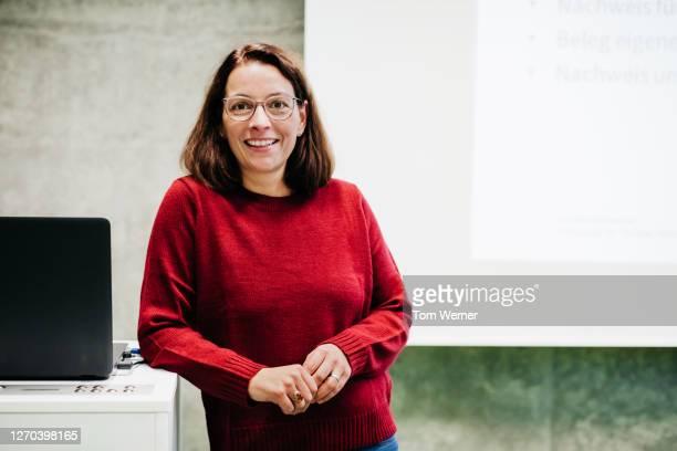 portrait of university tutor - teacher stock pictures, royalty-free photos & images
