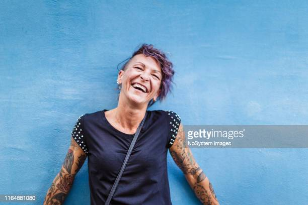 portrait of urban italian tattooed woman on the street - punk person stock pictures, royalty-free photos & images