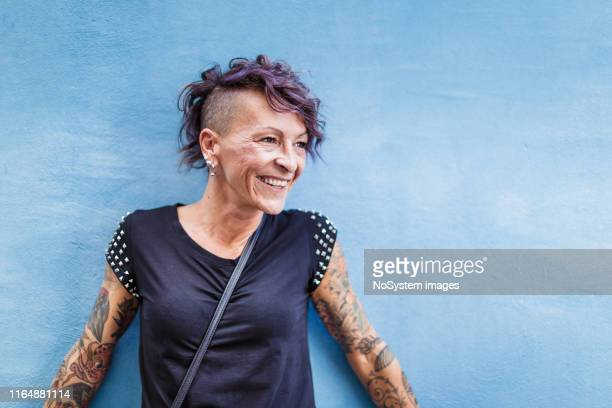portrait of urban italian tattooed woman on the street - half shaved hairstyle stock pictures, royalty-free photos & images