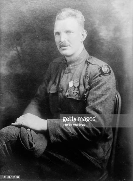 Portrait of US Army Sergeant Alvin York seated in his military uniform between 1915 and 1920