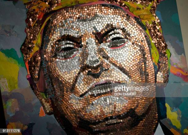 A portrait of US President Donald Trump created by Ukranian artists Daria Marchenko and Daniel Green is made of US pennies nickels and dimes and is...