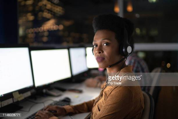 portrait of ustomer service representative working late in the office - hands free device stock pictures, royalty-free photos & images