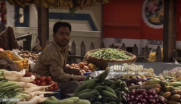 Portrait Of Vendor Selling Vegetables In Market