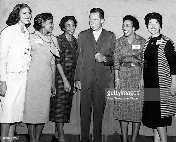 A portrait of Vice President Richard Nixon with hostesses from left to right Mesdames Thelma Gibson Natalie Werber Mignon Mundy and Miss Yvonne...