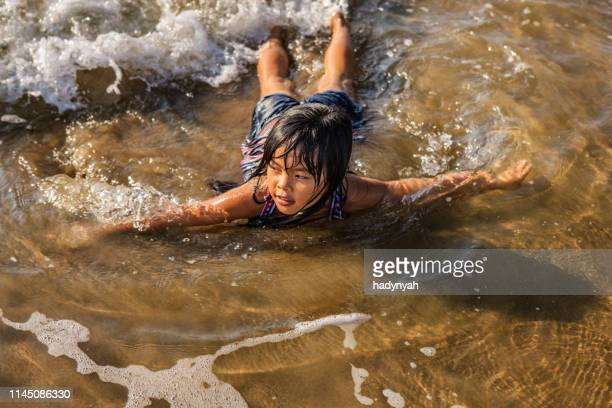 portrait of vietnamese little girl on the beach, vietnam - asian style conical hat stock pictures, royalty-free photos & images