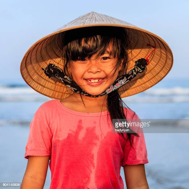 portrait of vietnamese little girl on the beach, vietnam - traditionally vietnamese stock pictures, royalty-free photos & images