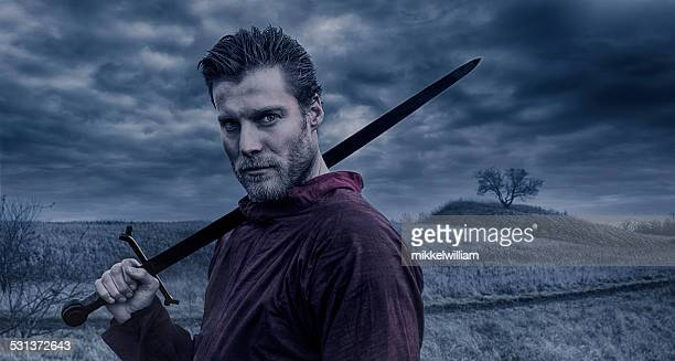 portrait of viking warrior holding a sword - warrior person stock photos and pictures
