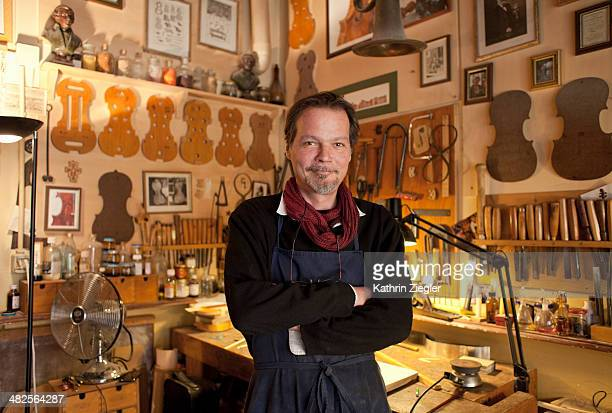 portrait of violin maker in his studio