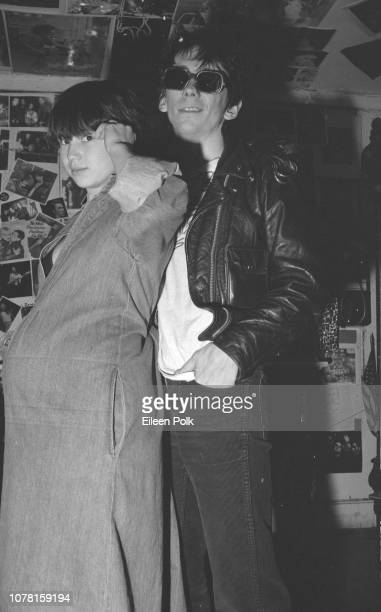 Portrait of visibly pregnant Damita Richter and Punk musician Stiv Bators of the group Dead Boys and as they pose togather in the clothing store...