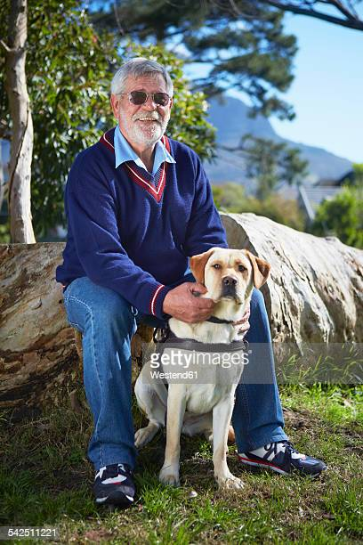 Portrait of visually impaired man and his guide dog