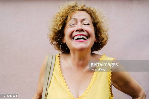 portrait of vivacious senior woman laughing with eyes closed - v neck stock pictures, royalty-free photos & images