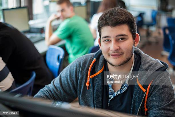 Portrait of vocational school student in computer lab