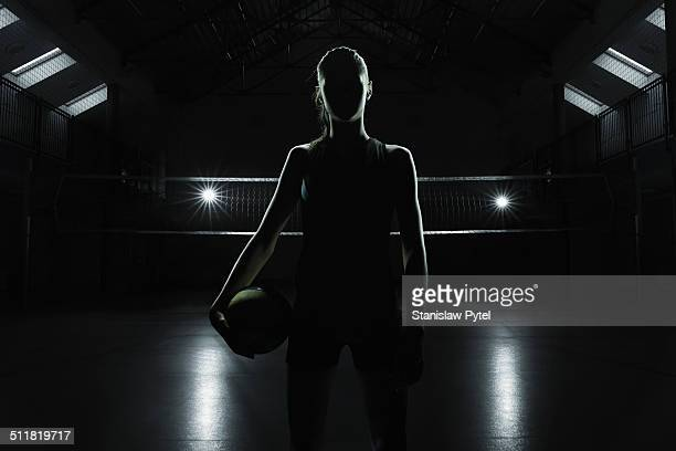 portrait of volleyball player in gym - volleyball mannschaftssport stock-fotos und bilder