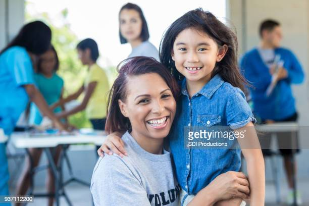 portrait of volunteer nurse with young patient - carers stock photos and pictures