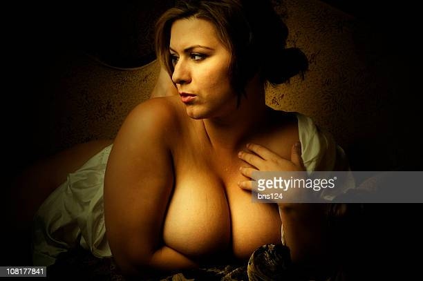 portrait of voluptuous woman and holding her cleavage - cleavage breasts stock photos and pictures