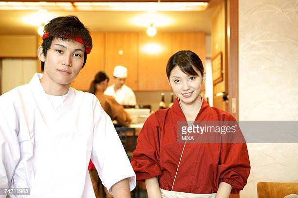 Portrait of waiter and waitress at Japanese restaurant