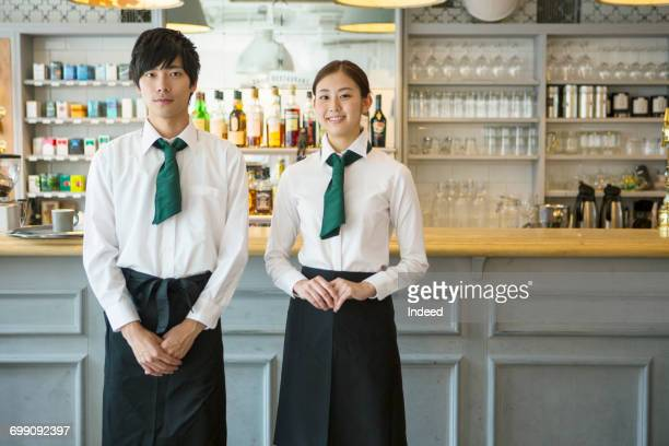 Portrait of waiter and waitress in restaurant