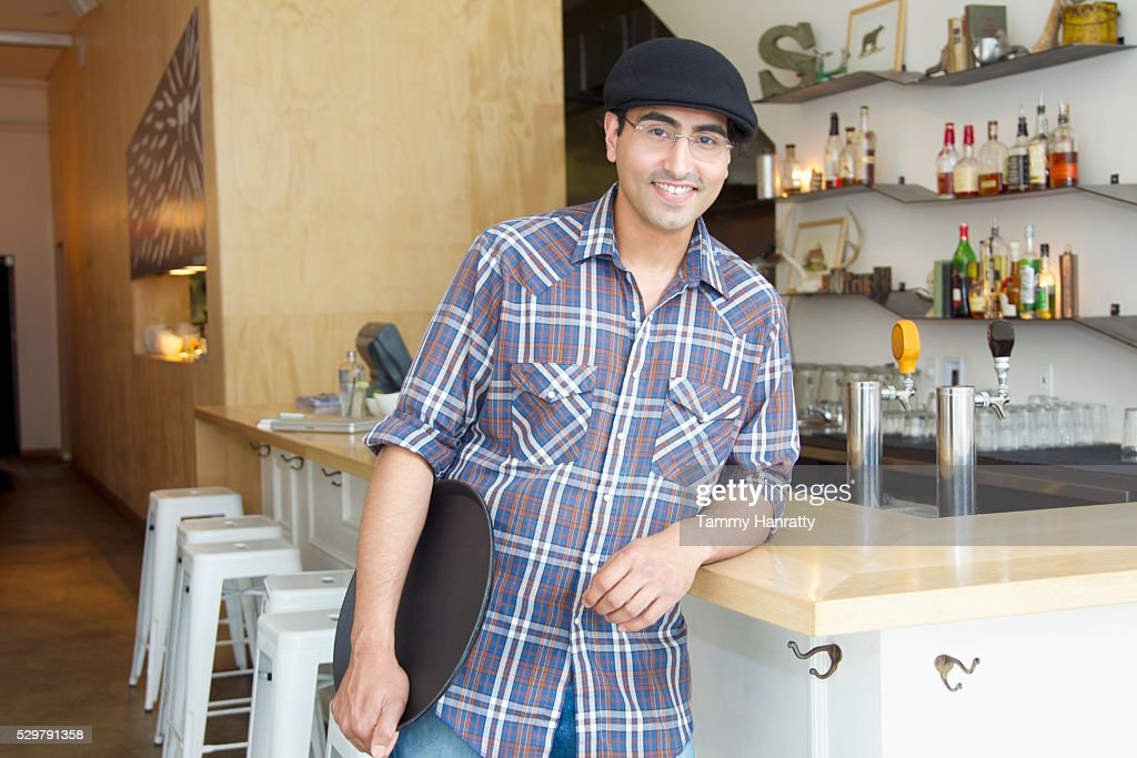 Portrait of waiter holding tray : Stock Photo