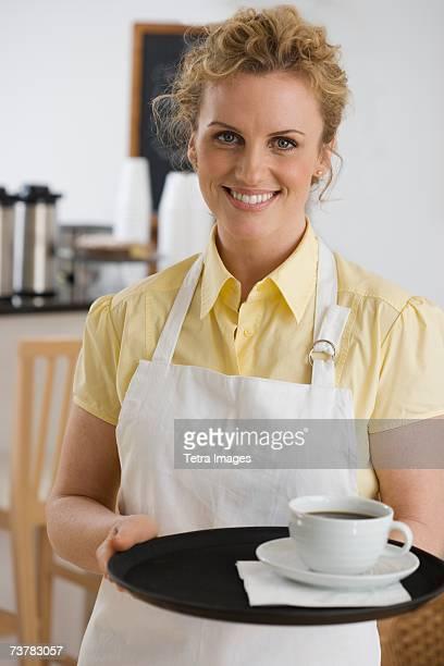 Portrait of waitress in cafe