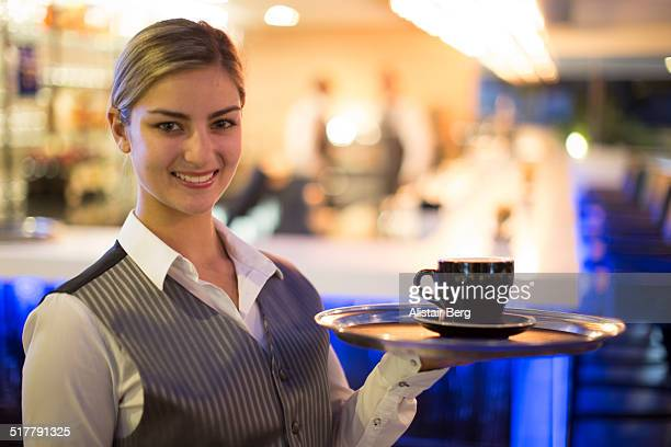 Portrait of waitress in hotel lounge