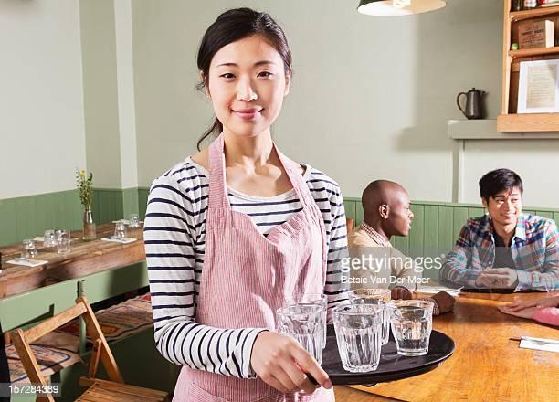 Portrait of waitress serving in restaurant.